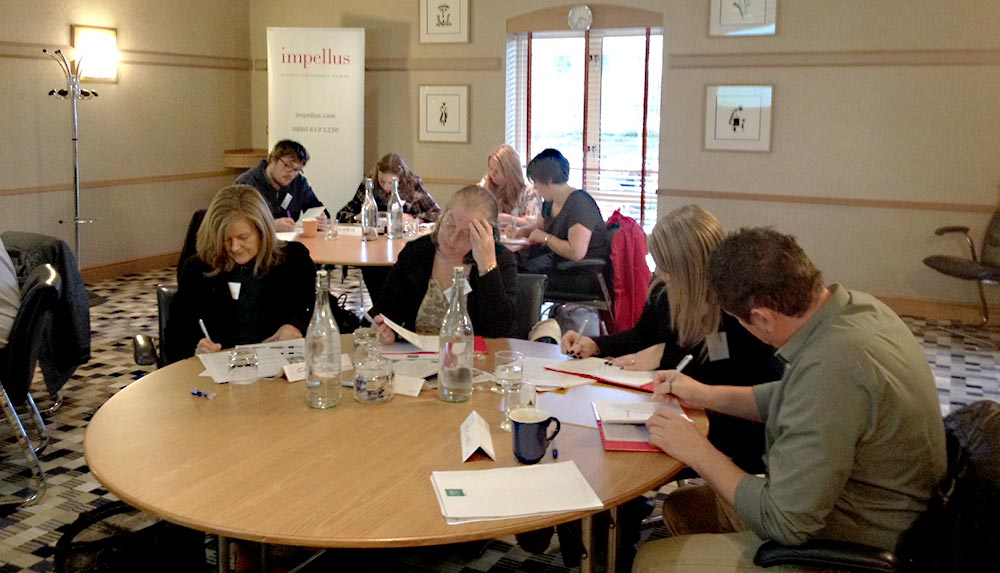 Delegates in management training meeting room in Leeds